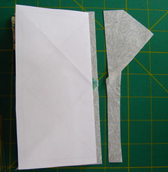 "Fold along top of 'goose' and trim, leaving 1/4"" seam allowance."