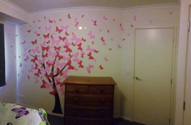 amy's room with butterfly wall
