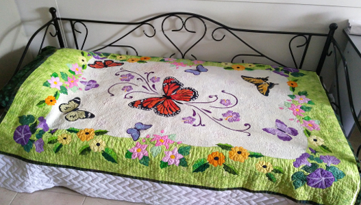 spring life by Ruth Blanchet displayed on bed
